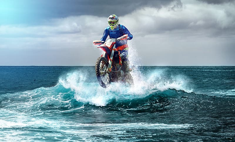 Person ride on motocross dirt bike on body of water