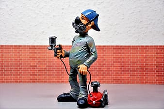 Man holding spray gun and canister