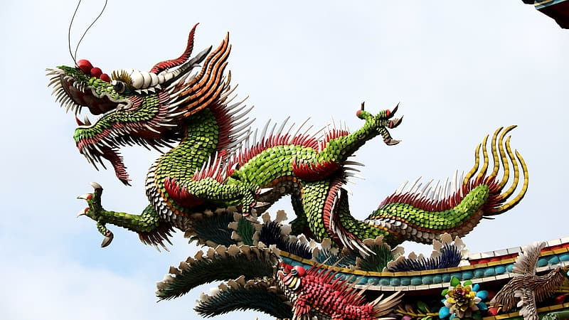 Green and red dragon statue