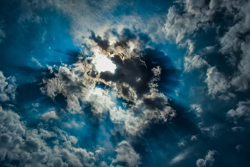 Time lapse photography of clouds and sun