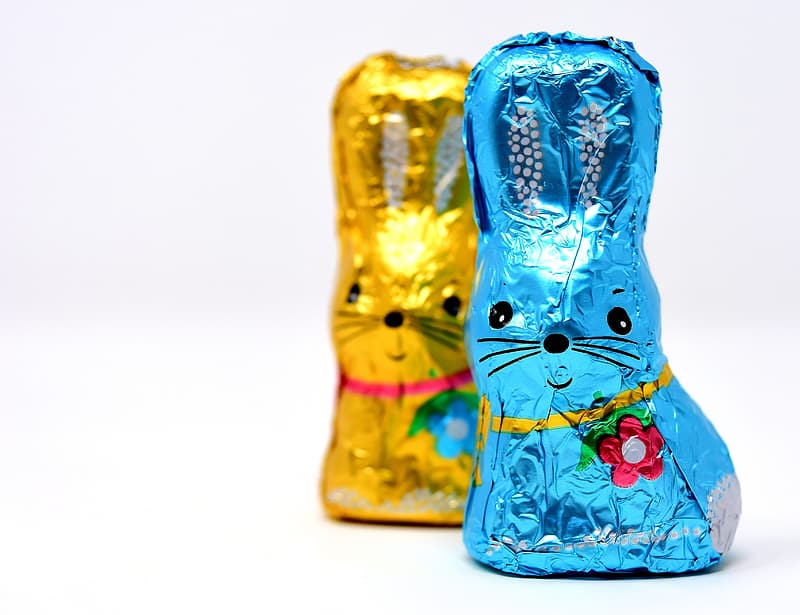 Closeup photo of blue and yellow rabbit chocolate pack on white surface