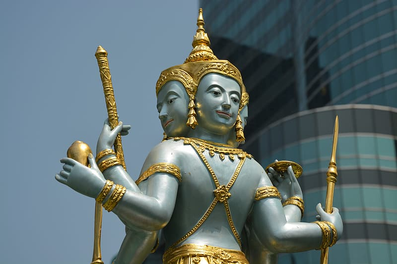 Gold hindu deity statue during daytime