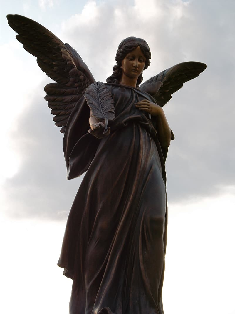 Black female angel statue under cloudy sky during daytime