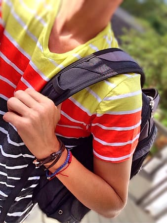 Person holding black backpack