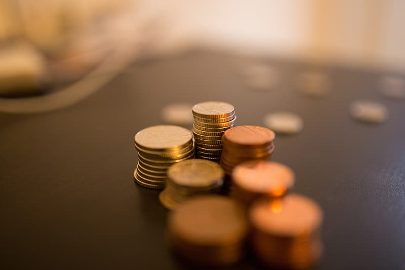 Selective focus of round silver-colored coin collection