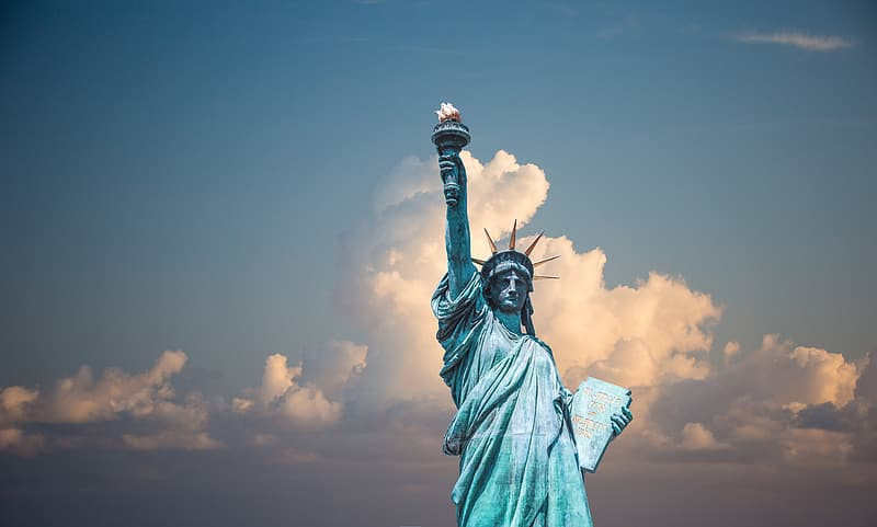 Statue of Liberty under cloudy blue sky during daytime