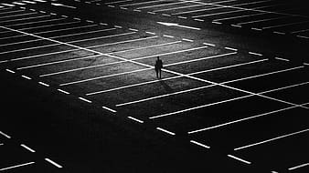 Person standing on parking lot