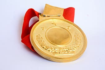 Gold medal on white surface