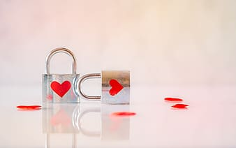 Heart shaped gold and red padlock