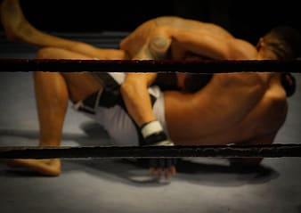 Mixed martial artist fighting inside ring