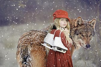 Girl in red and white dress holding a brown and white wolf