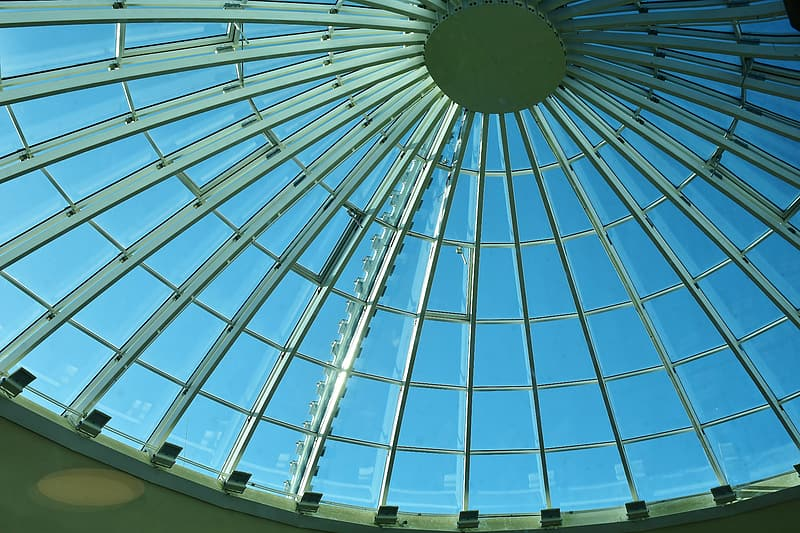 Low-angle photography of round building ceiling interior