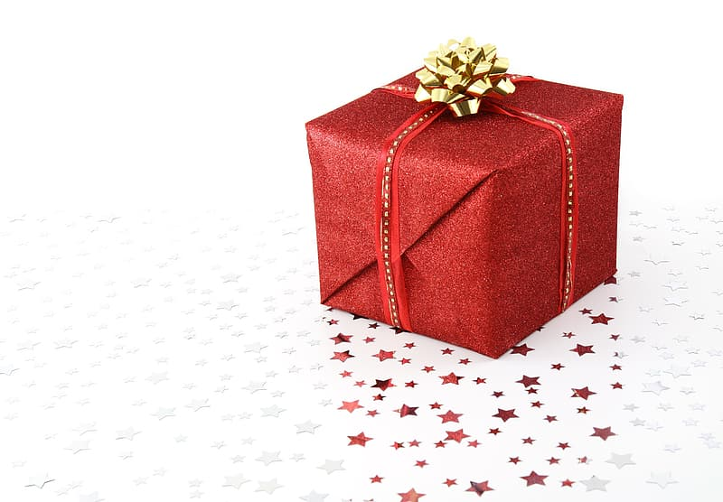 Red gift box on white surface