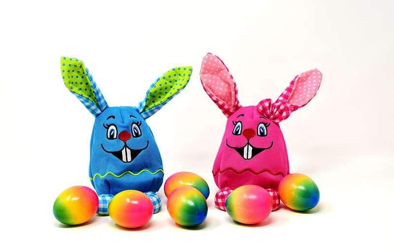 Minimalist photography of two blue and pink Easter bunny toys