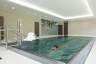 Woman swimming in indoor pool