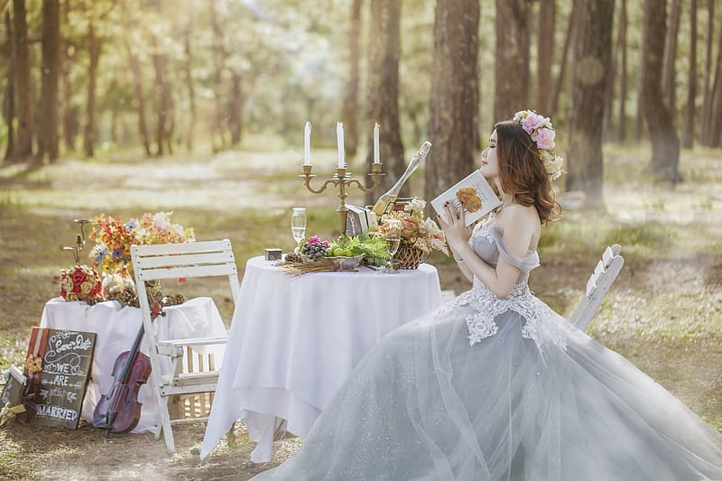 Woman in gray wedding gown sitting on chair