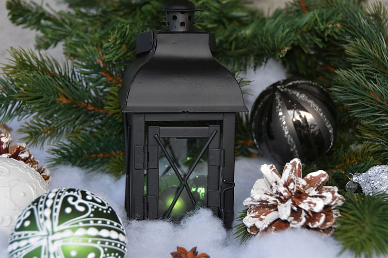 Black candle lantern and Christmas baubles