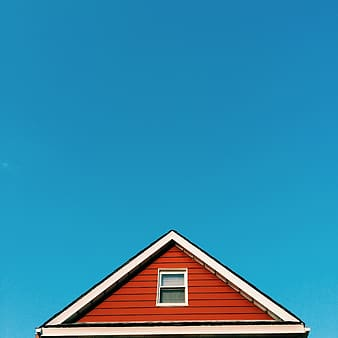 Triangular white and brown wooden house