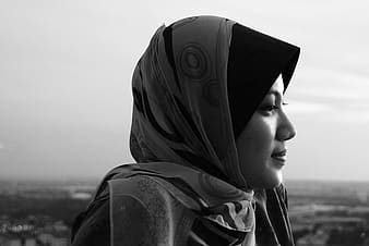 Gray scale photography of woman wearing hijab scarf