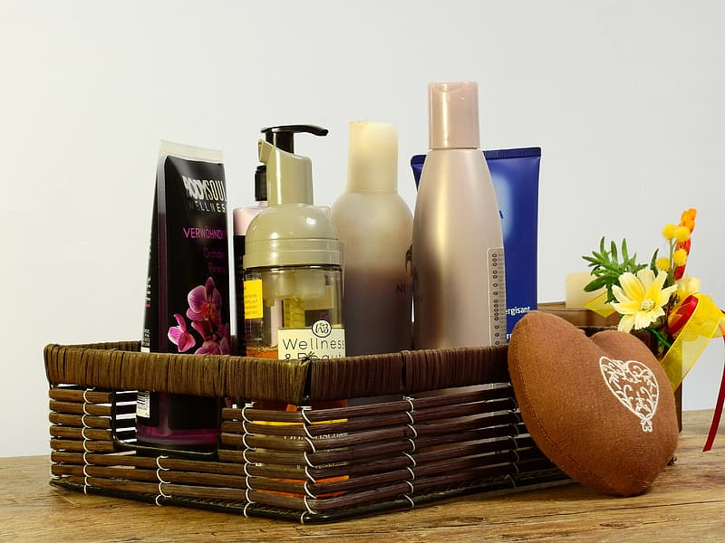 Cosmetic products in brown wicker basket