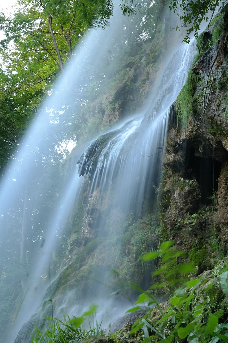 Waterfalls with green plant on the rock mountain