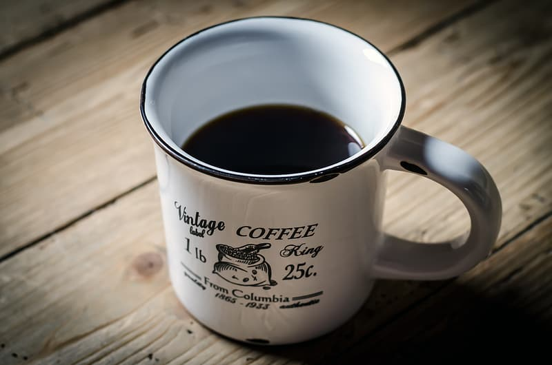 Half empty coffee on white ceramic mug