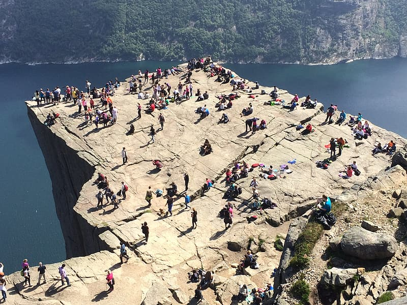 Crowd standing on cliff