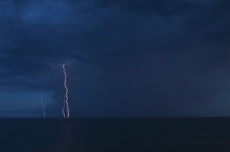 Landscape photography of thunder in horizon