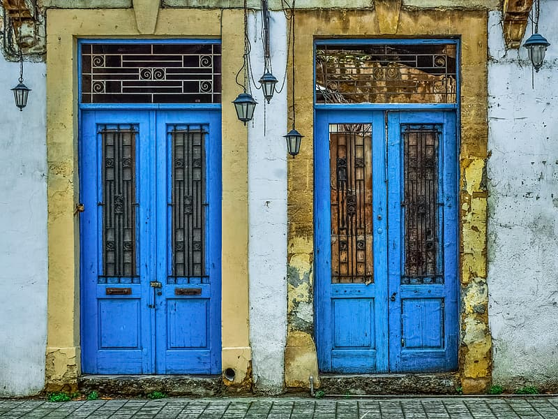 Two blue wooden closed doors