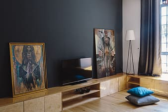 Black flat screen tv on brown wooden tv rack