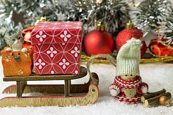 Red and white polka dot gift box on brown wooden table