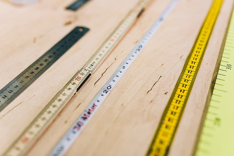 Close-ups of rulers on a wooden table