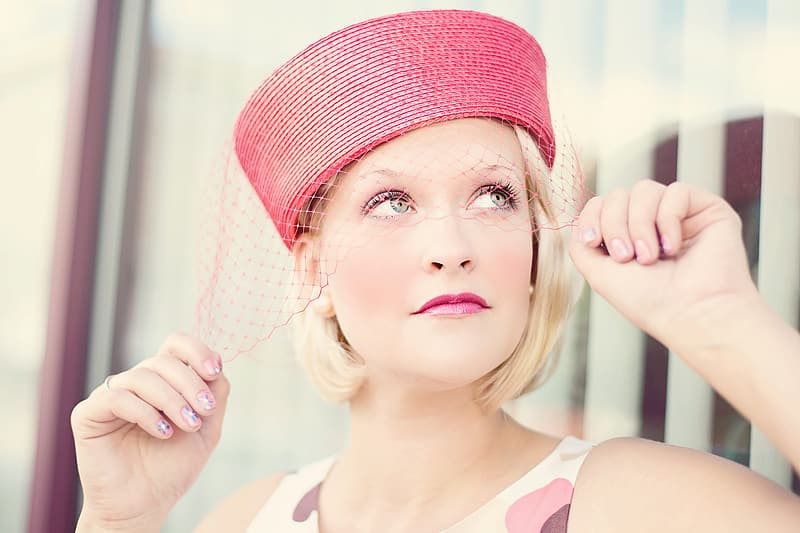 Woman with red lipstick and red hat
