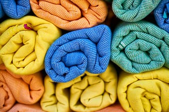 Several assorted-color rolled textiles