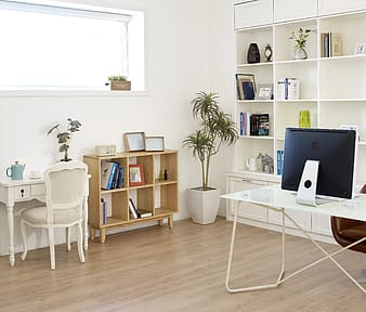 White wooden desk with chair