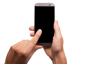 Person holding gray HTC One M8 smartphone