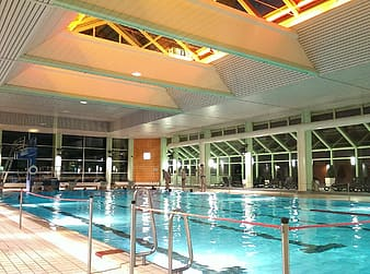 People standing on indoor swimming pool