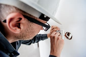 Person fixing power socket