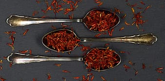 Stainless steel spoons with red and brown food