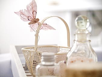 Beige basket with butterfly accent