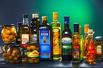 5 glass bottles with yellow fruit