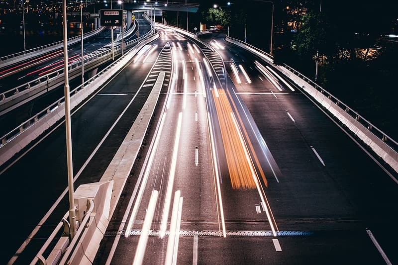 Time lapse photography of cars on road during night time