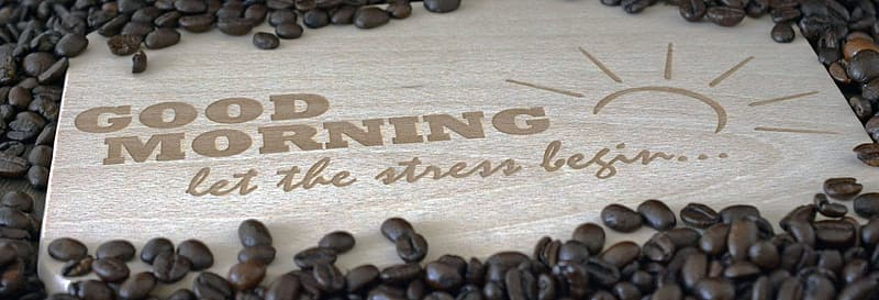Brown coffee beans with Good Morning Let the Stress begin text overlay