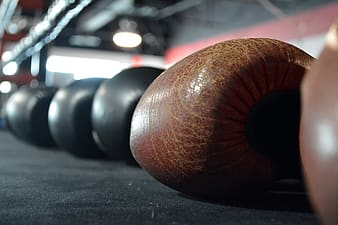 Closeup photography of brown boxing gloves