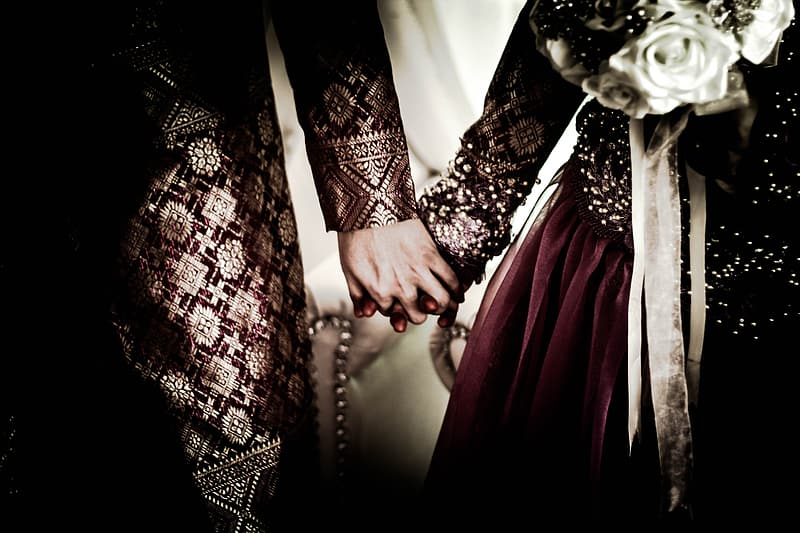 Newly wed couple holding hands