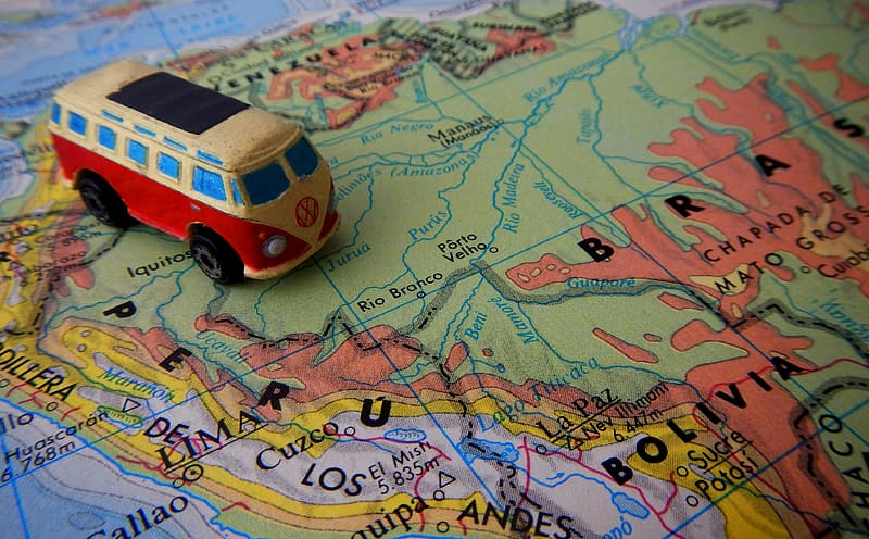 Red and yellow Volkswagen Transporter 2 scale model toy on map