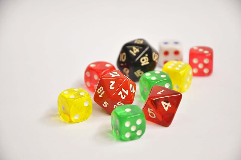 Red yellow green and blue dices