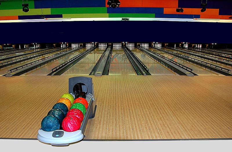 Several bowling balls in rack