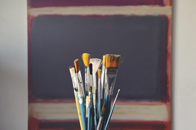 Assorted paint brushes in selective focus photography