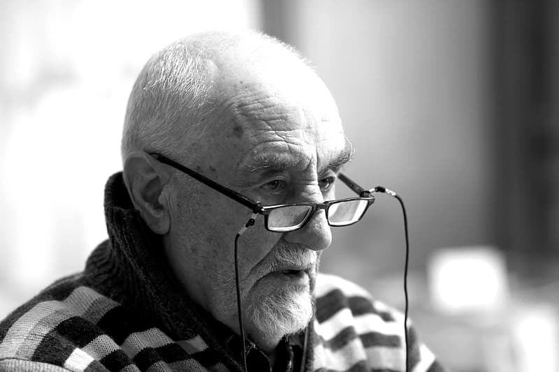 Man in eyeglasses grayscale photography
